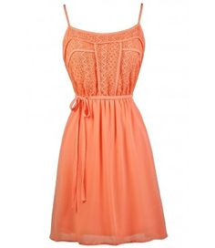 Lace designs flowy sundress in orange coral. I'd like it better in lilac.