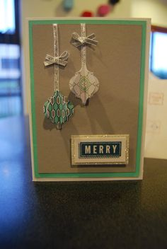We love how Helen Joronen made 3d ornaments on this merry card!