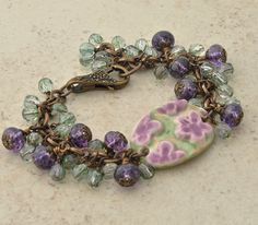 Cherry Blossom Ceramic Cuff Bracelet with Artisan Purple Lampwork and Crystal Sage Czech Glass Beads by gillianandlars ... Ceramic Cuff from #JeraLunaDesigns ... Lampwork Glass Beads from #ArtbyLisi