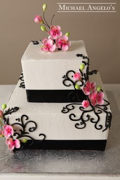 Cherry Blossom Beauty #90Ribbons This cake creation is a fun design with small pink cherry blossoms accented with the colors black and white.