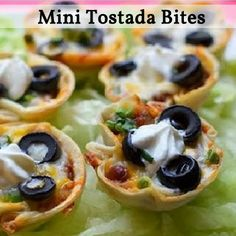 Mini Tostada Bites - A great poppable appetizer!  Using a cookie cutter or round lid cut circles out of tortilla's. (It's easier to cut them when they're cold). Pop the circles into the microwave for 10 seconds so that the tortilla's become more pliable. Press them into the bottom of a mini muffin pan. Top with your favorite filling then pop the tray into the oven at 425˚ F for 10-12 minutes, until the tortilla shells are crisp.  Garnish with sour cream, olives and pop away!