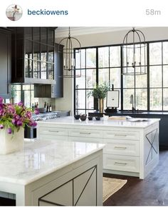 Beautiful Two Tone Kitchen Design With Black Mirrored Cabinets, White  Kitchen Cabinets With Glossy Black Countertops, Black Kitchen Island With  Beveled ...