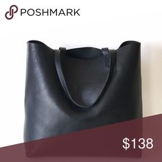 "Madewell • Transport True Black Beautiful tote with a lot of space for your daily essentials. Unlined interior; single zip pocket. Made of vegetable tanned leather, this bag will soften and age well over time! Can be carried comfortably or tossed on your shoulder. The perfect go-to tote!   14"" W x 14"" H x 6"" D Strap drop 8 1/4""  Condition: Purchased in Summer 15'. Light surface wear on body of bag, straps and corners, but well cared for and clean. Photos are of actual bag.  🌿No trades…"