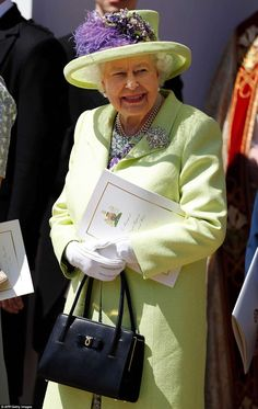 The Queen holds an order of service outside St George's Chapel in Windsor following the ro...