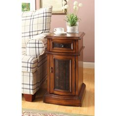 @Overstock.com - Oak Finish Side Table - This functional side table has a pull-out drawer for storage, plus a large cabinet design. This living space accent piece is ideal for use as a table to store your belongings.  http://www.overstock.com/Home-Garden/Oak-Finish-Side-Table/8346507/product.html?CID=214117 $164.99