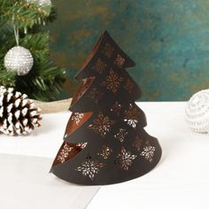 A stunning decoration for your home this festive season, this black and copper tea light holder can be placed on a mantel piece, windowsill or coffee table for a burst of colour and light. With decorative laser cut patterns, the glow from within when a candle is places inside is simply stunning. A fabulous gift idea for Christmas, Birthday or New Home; this tea light holder also makes a beautiful treat for yourself.