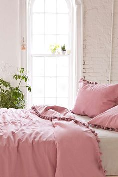 Magical Thinking Pom-Fringe Duvet Cover - Urban Outfitters i actually like the rose color