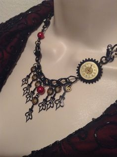 Steampunk Drop style Necklace with Black clock hands, vintage looking clock face and  Ruby Glass Pearls with matching Earrings - pinned by pin4etsy.com