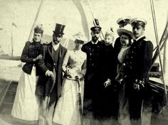 Princess Alexandra of Weles (later Queen of England), Prince George (later King George V), Grand Duchess Xenia, Prince Waldemar of Denmark with his wife, Princess Marie d'Orléans, Prince George of Greece (I think), Princess Marie of Greece and Tsarevich Nicholas (late Tsar Nicholas II).
