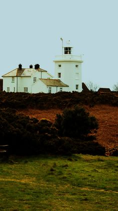 I want to live in a Lighthouse Keepers Cottage like this one. Bass Harbor Lighthouse, Lighthouse Lighting, Lighthouse Keeper, Old Buildings, Abandoned Buildings, Norfolk County, Norfolk England, All Over The World, Around The Worlds