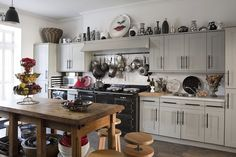 An Arts and Crafts altar table in the centre of a kitchen with Shaker style cabinets