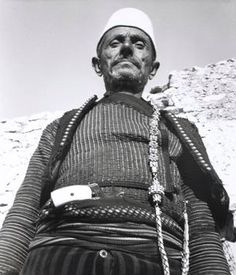 Old farmer with weapon stuck under his belt from Shkodra (Scutari),  Albania, 1934, by Denise Bellon. From the series: Reportages en Albanie et Europe orientale.