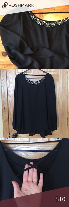 Maurice's Black Blouse Tunic Very pretty and flows! Longer length- 30 inches in back- so would be great with leggings or skinny jeans! Cute open/straps upper back detail, but can still wear a bra and camisole without it showing. Bling at neckline with 2 missing gems as pictured. Reposhing due to being too big! Maurices Tops Blouses