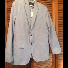 Banana Republic Men's Suit Jacket NWT Up for sell is a new, unworn men's Banana Republic tailored fit sports coat with a blue plaid and checks pattern. The jacket still has the tags with extra buttons. This sports jacket is 100% cotton with the lining made of a polyester mix. This coat will look great with a suit or jeans!   Brand: Banana Republic Size: 42R Color: Blue Plaid & Checks Banana Republic Jackets & Coats