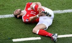 Wales' Gareth Bale holds his foot after a tackle by Northern Ireland's Stuart Dallas. Own Goal, Gareth Bale, Referee, Football Soccer, Northern Ireland, Wales, Euro, Running, Sports