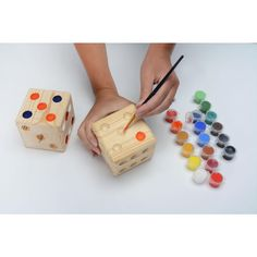 Giant wooden dice put a novel spin on tailgating and yard games. These super-sized dice are fun to roll!