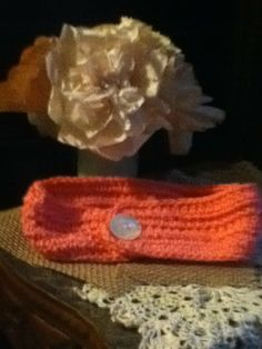 Pink headband with vintage button.
