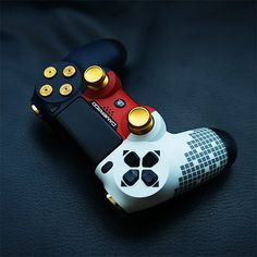 See custom video game controllers for Xbox One and PlayStation 4 consoles with beautifully detailed long-lasting designs. Ps4 Controller Custom, Xbox One Controller, Ps Wallpaper, Game Wallpaper Iphone, Ps4 Game Console, Video Game Console, Mundo Dos Games, Nintendo Switch Accessories, Video Game Rooms