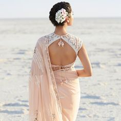 Wearing a saree or lehenga for the ceremony? Complete your chosen look with these simple blouse neck designs for the back, and all eyes will be on you. Netted Blouse Designs, New Blouse Designs, Stylish Blouse Design, Blouse Back Neck Designs, Saree Blouse Designs, Lehenga Designs, Anita Dongre, Design Page, Design Ideas