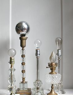 Oh my god check out the silver top one! I've never seen a bulb like that.  That is a lightbulb, right? Vintage Glass Hollywood Regency Lamp by ethanollie on Etsy, $45.00