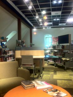 Wilbraham Library Teen Space: Open ceiling Bookstack with tackable display Teen-appropriate funky ambiance - developed with the Teen Advisory Committee