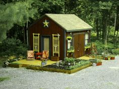 Garden shed with deck and raised beds