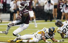 Mississippi State WR De'Runnya Wilson (1) falls into the end zone with a 25-yard touchdown pass reception, Aug. 30, 2014