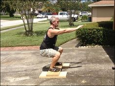 DIY Timed Static Contraction Squat with dipping belt and isometric chain device.