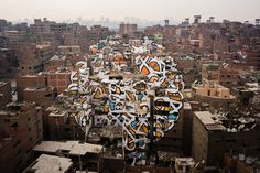 The artist eL Seed used more than 50 buildings as his canvas to celebrate the Egyptian capital's trash collectors, who are largely viewed as second-class citizens.