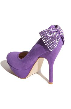 cute purple shoe. with a bow on the heel.