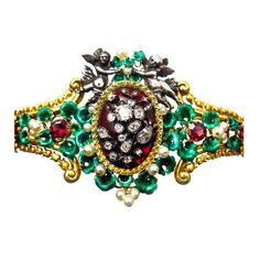 Antique Garnet and Diamond Gold Bracelet.   From a unique collection of vintage bangles at https://www.1stdibs.com/jewelry/bracelets/bangles/