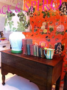 Bright botanical fabric with traditional chest.  Love the juxtaposition.