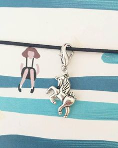 A single unicorn charm fixed to a lobster clasp. Perfect for attaching to your planner or TN, used as stitch marker or progress keeper or as a zipper or purse charm. Unicorn Gifts, Stocking Fillers, Organza Bags, Stitch Markers, Lobster Clasp, Handmade Items, Purse, Charmed, Zipper