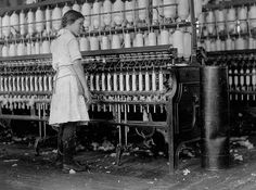"Brazos Valley Cotton mill 1913. Photographer Lewis Mills Vines. {Posted originally by ""Traces of Texas"",see them on Facebook. }This is a 12 yr.old girl working the hot, UN-air conditioned mill with no mask to wear to protect her from the fibers. All those spools!"