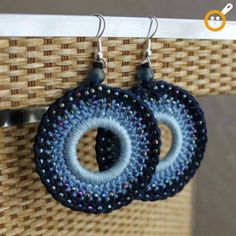 Beautiful shades of denim blue crochet earrings, with pretty little petrol seedbeads to catch the light.Althought these are large earrings, being made from soft cotton, makes them nice and light to wear (they wont pull down).Earrings are fitted. Crochet Earrings Pattern, Crochet Jewelry Patterns, Bead Crochet, Crochet Accessories, Crochet Necklace, Crochet Doilies, Crochet Rope, Bracelet Patterns, Denim Earrings