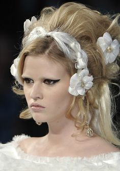 Chanel, Fall 2009, Amy Winehouse inspired makeup with flowers and teased hair.