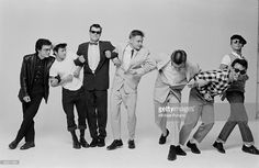 English pop/ska band Madness, during the cover shoot for their album '7', London, 1981. Left to right: Chris Foreman, Lee Thompson, Mike Barson, Chas Smash, Suggs, Mark Bedford and Daniel Woodgate.