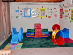 of my 1 year old son's basement playroom. Got school decorations from The Dollar Tree and lots of toys. Got more work to do but this is part of the finished product. I think it is quite cheerful for being in an unfinished basement. Basement Makeover, Basement Renovations, Unfinished Basement Playroom, Unfinished Basements, Baby Playroom, Playroom Ideas, Basement Ideas, Sick Kids, School Decorations