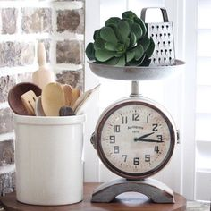 This Vintage Style Scale Clock is perfect for your farmhouse kitchen. Its made of metal with a rustic finish, it features a functioning clock face on each side with bold vintage style numbers. The dou