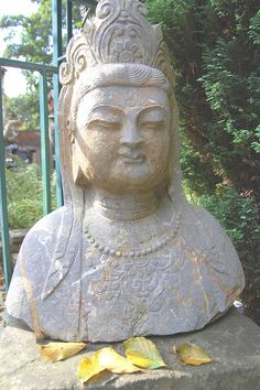 Kuan yin , Goddess of Children.  A fine sculpture carved from granite / quartz.