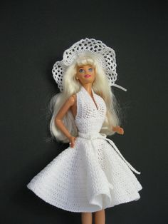 Marilyn Monroe  Barbie doll plus a hand crocheted dress and shoes. A all inclusive special gift for the little girl in your life.