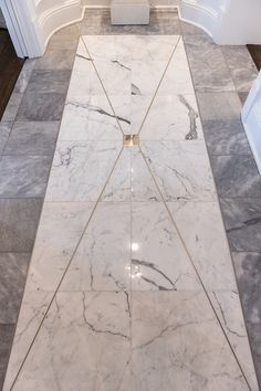 This House's Details make it a masterpiece The marble floor is custom designed. Robinson used nickel schluter strips between the marble to create a shiny accent. Design by Lee W.