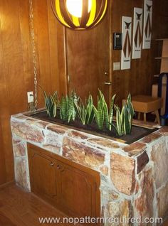 Stone planter in our family room.