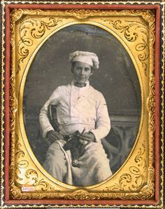 daguerreotype portrait of a kitchen or cook apprentice waring an apron, chef's hat, and holding a dead bird