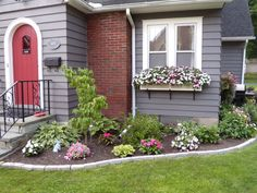 Front of house flower bed idea....maybe a redo sooner than later I hate the front of ours.