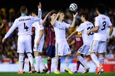 Lionel Messi of FC Barcelona argues with Luka Modric of Real Madrid CF during the Copa del Rey Final between Real Madrid and FC Barcelona at Estadio Mestalla on April 16, 2014 in Valencia, Spain.