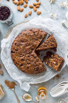 Vegan Christmas cake a rich moist and boozy vegan fruit cake that is perfect for the festive season Eat right away or make in advance and feed regularly with rum or bran. Vegan Fruit Cake, Vegan Dessert Recipes, Cake Recipes, Vegan Xmas Cake, Vegan Christmas, Christmas Desserts, Christmas Baking, Christmas Cakes, Christmas Foods