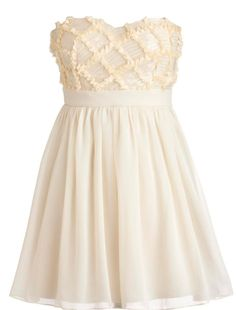 Buttercream Frosting Dress: Features a beautiful sweetheart neckline with padded bust for full support, twinkling sequins and delicately frayed ribbon decorating a buttercream bodice in a downy diamond pattern, nipped and neat waist for a figure-flattering effect, and airy layers of tulle and organza comprising the skirt to finish.