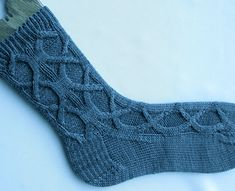 """This pattern is for a pair of ornately cabled socks. The cable itself is an old celtic cable that is not often seen but is just perfect for socks. There's enough """"give"""" to make them comfortable, but enough unusual cabling to make them interesting to look at and fun to knit."""