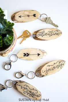 Make your own rustic DIY keychains with hand-lettered wood slices and resin. #resincrafts #destinationwedding #wander